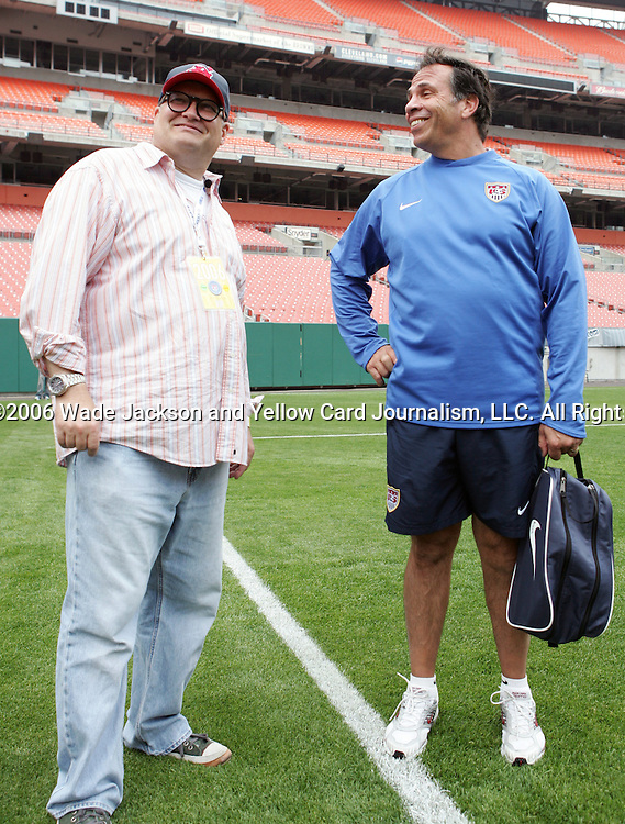 25 May 2006,  Coach Bruce Arena (r) with Drew Carey (l) talk after practice.  The USA Mens National soccer team held a practice session before taking on Venezuela in an international friendly match at Cleveland Browns Stadium in Cleveland, Ohio in their preparation for competition at World Cup 2006 in Germany.