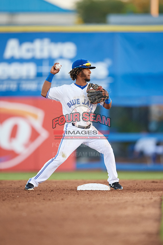 Dunedin Blue Jays second baseman Ivan Castillo (1) turns a double play during a game against the Fort Myers Miracle on April 17, 2018 at Dunedin Stadium in Dunedin, Florida.  Dunedin defeated Fort Myers 5-2.  (Mike Janes/Four Seam Images)