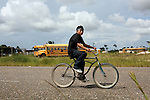 BELIZE - SEPTEMBER 13, 2007:  A boy rides his bike up the Southern Highway on September 13, 2007 in Belize.  (PHOTOGRAPH BY MICHAEL NAGLE)