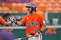 Junior infielder Weston Wilson (8) of the Clemson Tigers is congratulated after scoring in a fall practice intra-squad Orange-Purple scrimmage on Sunday, September 27, 2015, at Doug Kingsmore Stadium in Clemson, South Carolina. (Tom Priddy/Four Seam Images)
