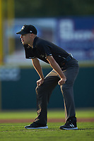 Umpire Matt Baldwin handles the calls on the bases during the South Atlantic League game between the Kannapolis Intimidators and the Hickory Crawdads at L.P. Frans Stadium on July 20, 2018 in Hickory, North Carolina. The Crawdads defeated the Intimidators 4-1. (Brian Westerholt/Four Seam Images)