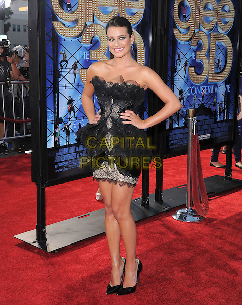 Lea Michele.attends The 20th Century Fox 'Glee 3D' Concert World Movie Premiere held at The Regency Village theatre in Westwood, California, USA, .August 6th 2011..full length ponytail  dress strapless black hair up tulle  lace tiered ruffles  pointy shoes heels walking mini hands on hips .CAP/RKE/DVS.©DVS/RockinExposures/Capital Pictures.