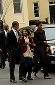 United States President Barack Obama, First Lady Michelle Obama and daughter Sasha Obama leave after services at St. John's Church, on Sunday, March 18, 2012, in Washington, DC.  .Credit: Leslie E. Kossoff / Pool via CNP