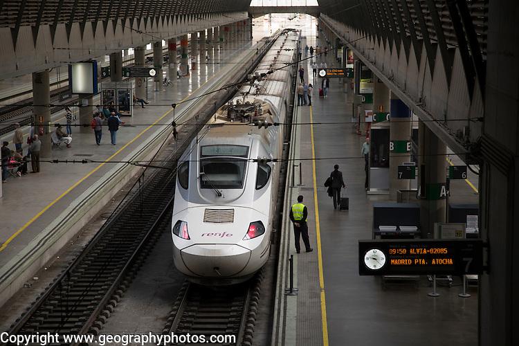 Train at platform inside Santa Justa railway station, Seville, Spain
