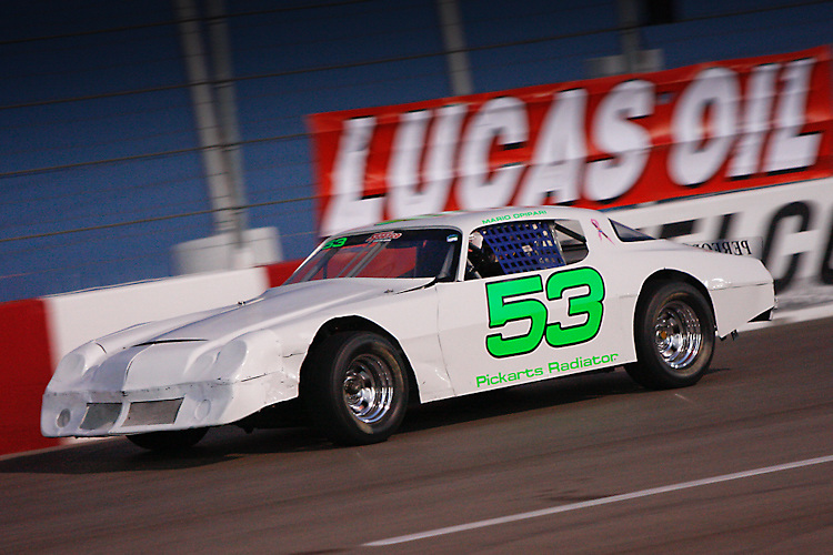 Mario Opipari races down the backstretch in his number 53 charger at the Bullring at LVMS in Las Vegas, NV.