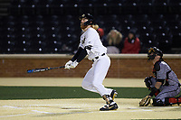 William Simoneit (8) of the Wake Forest Demon Deacons watches the flight of his walk-off home run in the bottom of the ninth inning against the Louisville Cardinals at David F. Couch Ballpark on March 7, 2020 in  Winston-Salem, North Carolina. The Demon Deacons defeated the Cardinals 3-2. (Brian Westerholt/Four Seam Images)