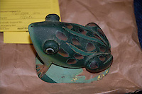 "COPY BY TOM BEDFORD<br /> Pictured: The stone frog garden ornament that was used to kill John Sabine.<br /> Re: A man found wrapped in plastic in his Rhondda Cynon Taff garden was unlawfully killed, a coroner has concluded.<br /> The body of John Henry Sabine was found at the rear of flats at Trem-y-Cwm, Beddau, on 24 November. The cause of death was blunt force head trauma.<br /> Mr Sabine's wife Leigh Ann, who died last October, is the main suspect.<br /> His inquest in Aberdare was told she admitted killing her husband with a stone frog in a phone call to a friend.<br /> South Wales Central Coroner Andrew Barkley said it was ""beyond doubt in my mind that foul play was the cause of his death"".<br /> He said the cause was blunt force injury to the head, with the evidence about the stone frog fitting with this.<br /> The coroner said there was no recorded history of domestic violence or that Mrs Sabine acted in self defence and he was satisfied her husband was unlawfully killed."
