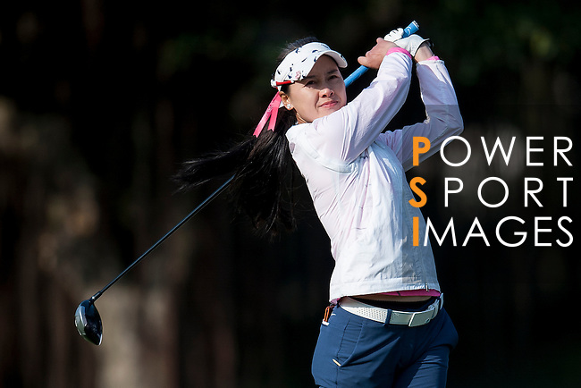 Lanlan Song of China hits her shot during the Hyundai China Ladies Open 2014 at World Cup Course in Mission Hills Shenzhen on December 13 2014, in Shenzhen, China. Photo by Xaume Olleros / Power Sport Images
