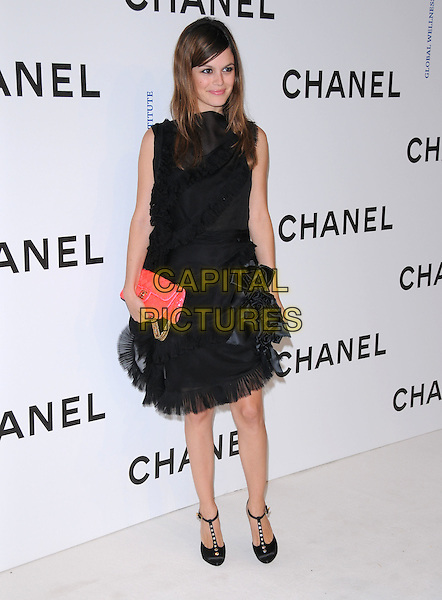 RACHEL BILSON.at The Chanel Boutique Opening on Robertson Blvd. in Beverly Hills, California, USA, May 29 2008..full length black dress red bag sequined beaded bar shoes flowers corsages t-bar strap.CAP/DVS.©Debbie VanStory/Capital Pictures