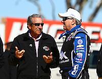Feb 3, 2016; Chandler, AZ, USA; NHRA team owner Don Schumacher (left) talks with funny car driver John Force during pre season testing at Wild Horse Pass Motorsports Park. Mandatory Credit: Mark J. Rebilas-USA TODAY Sports