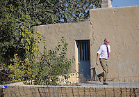 FAO JANET TOMLINSON, DAILY MAIL PICTURE DESK<br /> Pictured: Jon Cousins of South Yorkshire Police walks past the house where Ben Needham disappeared from, part of which (FAR LEFT) will be demolished for the search in Kos, Greece. Monday 03 October 2016<br /> Re: Police teams led by South Yorkshire Police, searching for missing toddler Ben Needham on the Greek island of Kos have moved to a new area in the field they are searching.<br /> Ben, from Sheffield, was 21 months old when he disappeared on 24 July 1991 during a family holiday.<br /> Digging has begun at a new site after a fresh line of inquiry suggested he could have been crushed by a digger.