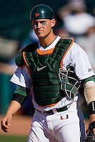 Catcher Yasmani Grandal #24 of the Miami Hurricanes on defense against the Florida State Seminoles at the 2010 ACC Baseball Tournament at NewBridge Bank Park May 26, 2010, in Greensboro, North Carolina.  The Hurricanes defeated the Seminoles 9-3.  Photo by Brian Westerholt / Four Seam Images