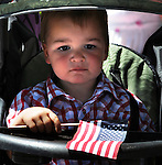 One of the many children who were watching from the sidewalk as the Independence Day Parade marched past in Saugerties, NY on Thursday, July 4, 2013. Photo by Jim Peppler. Copyright Jim Peppler 2013 all rights reserved.