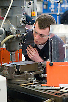 Milling a slot using a slot drill on a vertical milling machine.  Apprentice engineering students at Kingston College..