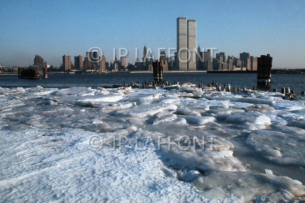 New York City, New York, 01 January 1977: Lower Manhattan Skyline showcasing the World Trade Center in the midst of winter
