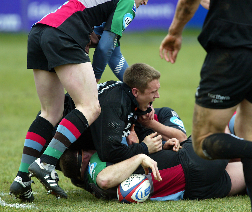 Photo. Chris Ratcliffe..NEC Harlequins v Newcastle Falcons. Zurich Premiership. 13/03/2005..Jonny Wilkinson in the tackle that meant he had to leave the pitch injured in his first game back.