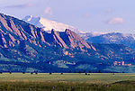 snowcapped Longs Peak and Mt Meeker rise above the Flatirons near Boulder, Colorado, USA