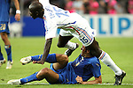09 July 2006: Lilian Thuram (FRA) (15) gets tangled with Luca Toni (ITA) (9). Italy tied France 1-1 in overtime at the Olympiastadion in Berlin, Germany in match 64, the championship game, of the 2006 FIFA World Cup Finals. Italy won the World Cup by defeating France 5-3 on penalty kicks.