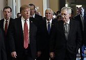 United States President Donald J. Trump walks with US Senate Majority Leader Mitch McConnell (Republican of Kentucky) and US Vice President Mike Pence after the Republican luncheon at the U.S. Capitol Building on January 9, 2019 in Washington, DC.  Also pictured are US Senator John Barrasso (Republican of Wyoming), left, and US Senator John Thune (Republican of South Dakota), who is walking behind the President.<br /> Credit: Olivier Douliery / Pool via CNP