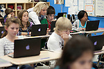 November 15, 2011. Mooresville, NC. . Mrs. Rigby, center, helps Thor Abbasi with his 5th grade science lesson at East Mooresville Intermediate School. Many of the in-class lessons are done on school issued laptops and turned in to the teacher via networked printer.. The Mooresville school system has become nationally known for being on the cutting edge of using technology as an educational tool. Starting in 3rd grade, each student is issued their own laptop that they will use in class and at home to further their learning.