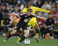 Dax McCarty#10 of D.C. United  moves away from Emmanuel Ekpo#17 of the Columbus Crew during the opening match of the 2011 season at RFK Stadium, in Washington D.C. on March 19 2011.D.C. United won 3-1.