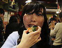 December 24, 2016, Tokyo, Japan - A woman eats a canape with a locust at a Christmas party to eat insect foods in Tokyo on Saturday, December 24, 2016. Some 30 people gathered to eat insect foods on the Christmas Eve as UN FAO reported that eating insects could help boost nutrition and reduce pollution.  (Photo by Yoshio Tsunoda/AFLO) LWX -ytd-