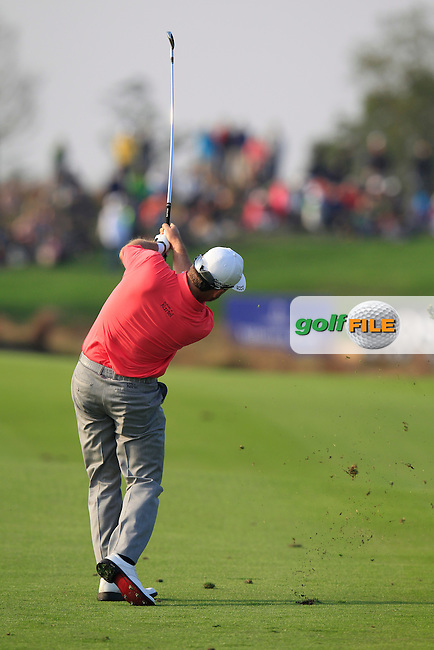 Graeme McDowell (NIR) plays his 2nd shot on the 16th hole during Sunday's Final Round of the 2014 BMW Masters held at Lake Malaren, Shanghai, China. 2nd November 2014.<br /> Picture: Eoin Clarke www.golffile.ie