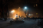 Jersey City, United States. 11th February 2013 -- A man walks with his dogs during a foggy night at Jersey City in New Jersey. Photo by Eduardo Munoz Alvarez / VIEWpress.