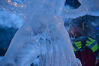 Keven Laughlin carves details into his sculpture of a Warhammer character on the final morning of the 2016 Crystal Gallery of Ice Ice Carving Competition in town square.