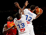 France's guards Rudy Gobert and Boris Diaw vies with Spain's forward Serge Ibaka during the 2014 FIBA World basketball championships quarters of final match Spain vs France at the Palacio de los Deportes in Madrid on September 10, 2014.  PHOTOCALL3000 / DP