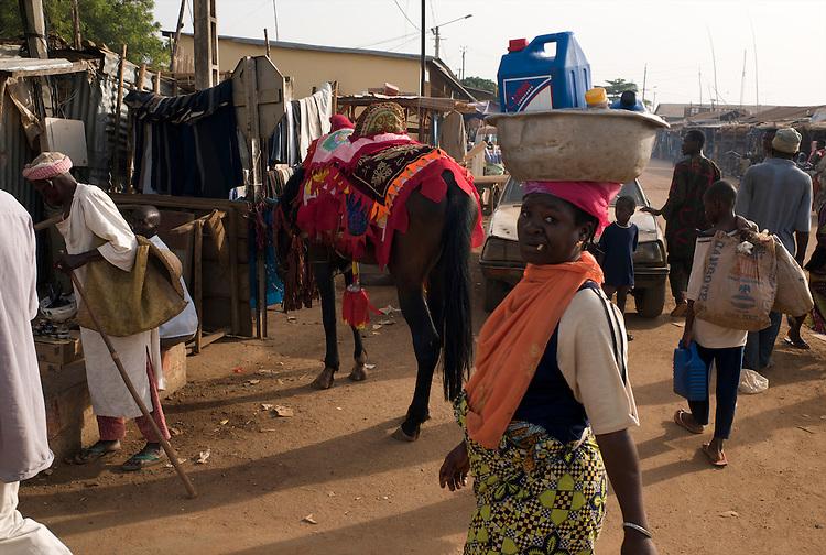 Moussa Atta on his way to the street caf&eacute; for his breakfast.<br />  <br /> Moussa Atta en route vers le caf&eacute; de rue pour prendre son petit-d&eacute;jeuner.