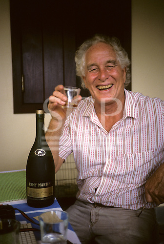Rio de Janeiro, Brazil; Great Train Robber Ronnie Biggs at home relaxing with a Remy Martin brandy.
