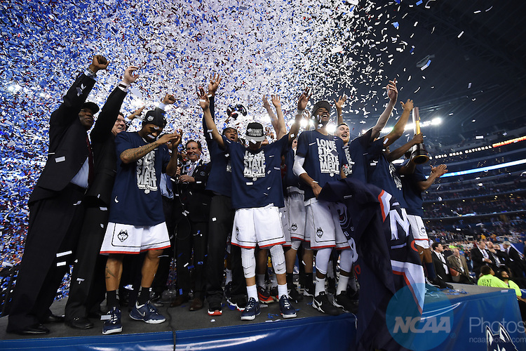 07 April 2014: The University of Connecticut celebrates after defeating the University of Kentucky during the 2014 NCAA Men's DI Basketball Final Four Championship at AT&T Stadium in Arlington, TX. Connecticut defeated Kentucky 60-54 to win the national title. Peter Lockley/NCAA Photos