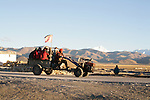 "Tibetan farmers ride a ""tractor"" home from Old Tingiri with Mt. Everest in background."