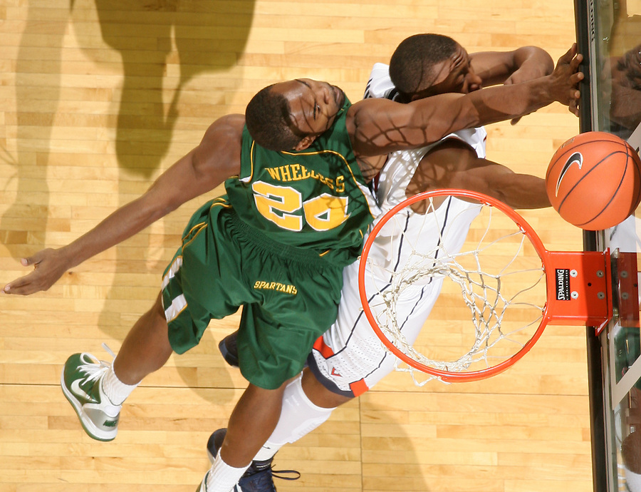 Dec. 20, 2010; Charlottesville, VA, USA; Norfolk State Spartans guard/forward Brandon Wheeless (24) shoots the ball in front of Virginia Cavaliers center Assane Sene (5) during the game at the John Paul Jones Arena. Virginia won 50-49. Mandatory Credit: Andrew Shurtleff