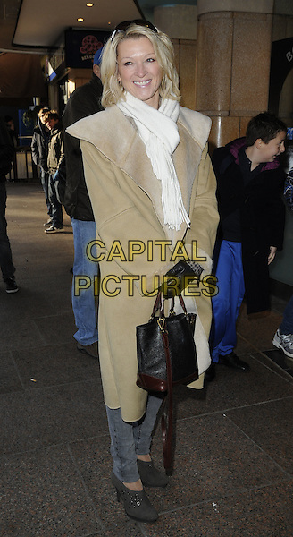 "GILLIAN TAYLFORTH .The ""Megamind"" Gala screening, Vue Cinema, Leicester Square, London, England..November 28th, 2010.full length black white beige grey gray scarf coat jacket shoes bag purse gloves .CAP/CAN.©Can Nguyen/Capital Pictures."