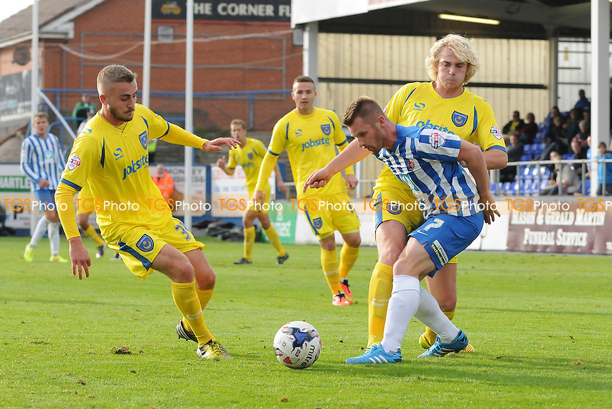 Jonathan Franks of Hartlepool United battles with Jack Whatmough of Portsmouth - Hartlepool United vs Portsmouth - Sky Bet League Two Football at Victoria Park, Hartlepool - 27/09/14 - MANDATORY CREDIT: Steven White/TGSPHOTO - Self billing applies where appropriate - contact@tgsphoto.co.uk - NO UNPAID USE
