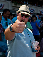 ELMONT, NY - JUNE 10: A fan gives a thumbs-up to the camera on Belmont Stakes Day at Belmont Park on June 10, 2017 in Elmont, New York (Photo by Scott Serio/Eclipse Sportswire/Getty Images)