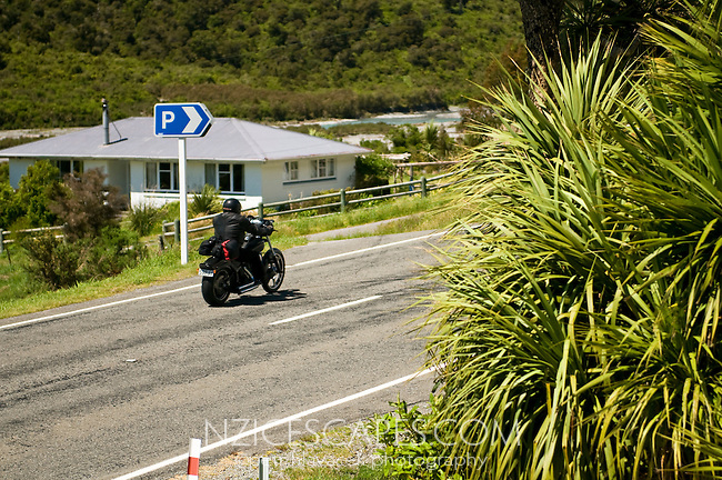Rider on the road towards the Arthur's Pass. New Zealand
