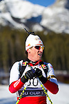 Austrian biathlon athlete Friedrich Pinter catches his breath after crossing the finish line at The International Biathlon Union Cup # 7 Men's 10 KM Sprint held at the Canmore Nordic Center in Canmore Alberta, Canada, on Feb 16, 2012.  Friedrich takes 2nd place in the sprint.  Photo by Gus Curtis