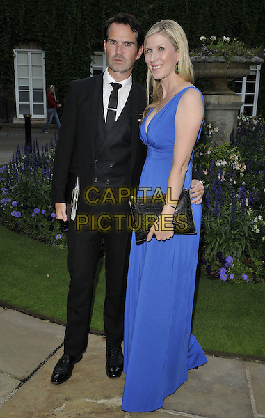LONDON, ENGLAND - AUGUST 28: Jimmy Carr &amp; Karoline Copping attend the Mo Farah Foundation &quot;A Night Of Champions&quot; Dinner, The Hurlingham Club, Ranelagh Gardens, on Thursday August 28, 2014 in London, England, UK. <br /> CAP/CAN<br /> &copy;Can Nguyen/Capital Pictures