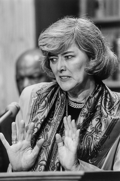 Rep. Patricia Schroeder, D-Colo., on Speaker Newt Gingrich's, R-Ga., book tour with Rep. John Lewis, D-Ga., (background) on May 29, 1995. (Photo by Laura Patterson/CQ Roll Call)