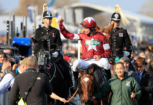 14h April 2018, Aintree Racecourse, Liverpool, England; The 2018 Grand National horse racing festival sponsored by Randox Health, day 3;  Davy Russell celebrates winning the Grand National on Tiger Roll