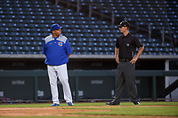 AZL Cubs 1 manager Carmelo Martinez argues with umpire Michael Corbett during an Arizona League game against the AZL Royals on June 30, 2019 at Sloan Park in Mesa, Arizona. AZL Royals defeated the AZL Cubs 1 9-5. (Zachary Lucy/Four Seam Images)