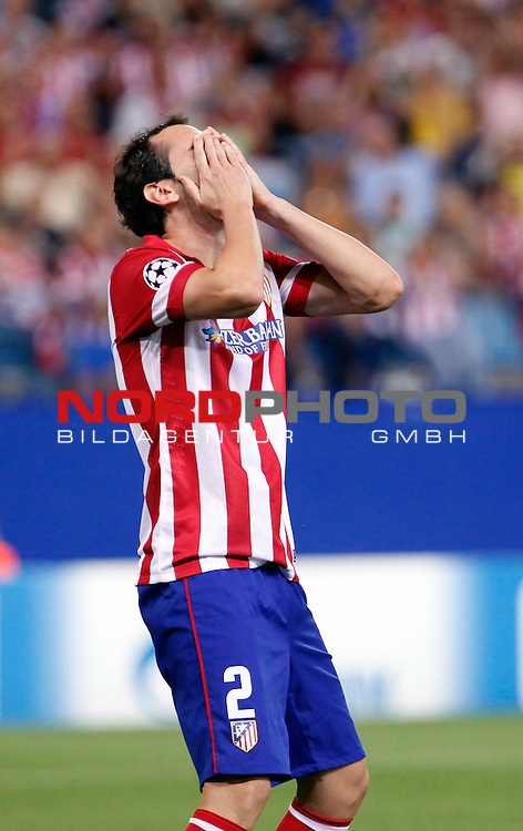 Atletico de Madrid's Diego Godin regres missing a goal during Champions League 2013/2014 match.September 18,2013. Foto © nph / Victor Blanco)