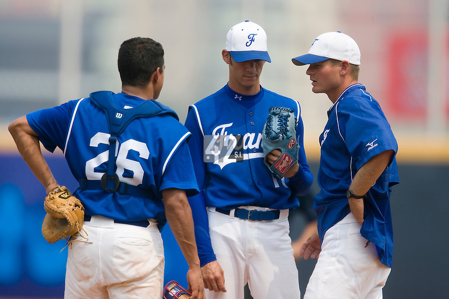 18 August 2007: Catcher #26 Jamel Boutagra and team manager Jeff Zeilstra (right) talk to pitcher #11 Matthieu Brelle Andrade during the China 5-1 victory over France in the Good Luck Beijing International baseball tournament (olympic test event) at the Wukesong Baseball Field in Beijing, China.