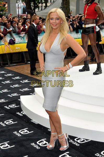 LIZ FULLER .UK film premiere of 'Bruno', at Empire Leicester Square on 17th June  2009 in London, England.full length light blue low cut plunging neckline cleavage dress hands on hips Herve Leger bandage silver shoes  .CAP/PL.©Phil Loftus/Capital Pictures