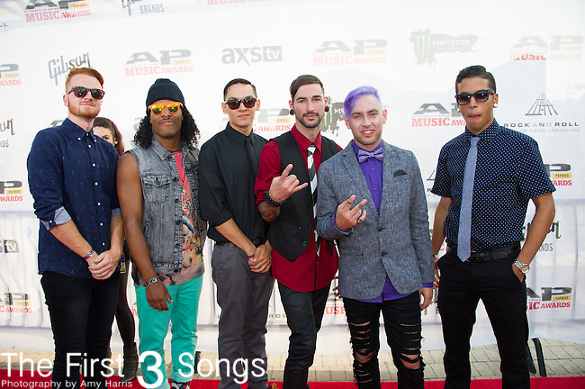 Tyler Carter, Michael Bohn, AJ Rebollo, Tyler Acord, Skyler Acord, and Josh Manuel of Issues attend the 2014 AP Music Awards at the Rock And Roll Hall Of Fame and Museum at North Coast Harbor in Cleveland, Ohio.