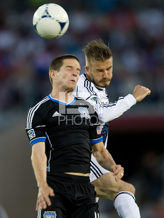 Sam Cronin of Earthquakes fights for the ball in the air against David Beckham of Galaxy during the game at Stanford Stadium in Palo Alto, California on June 30th, 2012.  San Jose Earthquakes defeated LA Galaxy, 4-3.