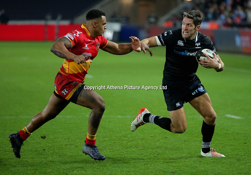 James Hook of the Ospreys (R) is closely followed by Ashton Hewitt of the Dragons (L) during the Guinness PRO14 match between Ospreys and Dragons at The Liberty Stadium, Swansea, Wales, UK. Friday 27 October 2017